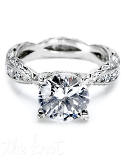 Platinum and diamond Engagement Ring from the Contemporary Crescent Silhouette Collection. This ring is pictured with a round brilliant-cut center stone, and the criss-cross style eternity band is filled with round channel-set diamonds and accented with round pave-set diamond details. This setting is also available in Petite and Medium proportions. Matching wedding band is style 2578 B.