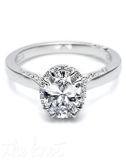 "From our ""Dantela"" Collection, this unique setting creates a look that is a beautiful juxtaposition of modern, yet traditional; classic, yet unconventional. This stunning ring features an Oval center stone with diamond enhancers blooming the center stone.  This gorgeous setting is also available in Grande or Petite proportions, with an Emerald cut, Round or princess cut center, and with pave shoulders."