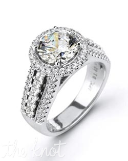 18K White Gold Semi Mount featuring .57cttw round white diamonds and .47cttw princess cut diamonds.