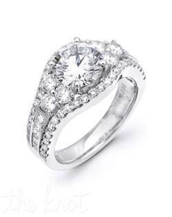 18K White Gold Semi Mount featuring .90cttw natural round white diamonds and .23cttw princess cut diamonds.