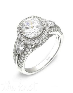 18K White Gold Semi Mount featuring .65cttw round white diamonds and .47cttw pear shaped diamonds.