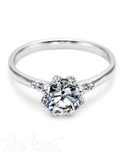 A diamond solitaire is made even more lovely by two round brilliant diamonds along the mirror-smooth shoulders and accent diamonds set in outer edges of the center stone for a cool, uncomplicated look. Matching band is style 2522.