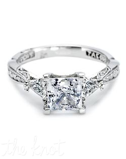 For the modern beauty with a careful eye for design, this platinum and diamond engagement ring features two trillion-cut diamonds framing a princess-cut center stone. Delicate filigree details and rows of diamonds establish the Tacori look - and your love - in perfect symmetry. Matching band style is 2550.