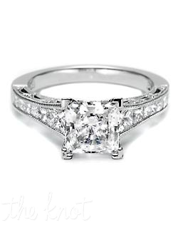 Declare your devotion with this stunning tapered princess-cut engagement ring. Channel-set princess-cut diamonds taper into trapezoids to illuminate a princess-cut center stone. Crescent silhouettes allow light into the setting, with a delicate milligrain detail finish. Matching band is style 2556PR.
