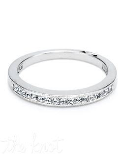 A straight band of bright princess-cut diamonds set in a channel of signature Tacori milligrain.