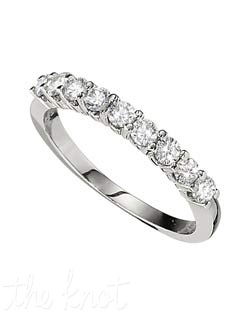 "The classics never go out of style, this 9 stone ""shared prong"" setting ring features 0.50 ct in diamonds.  We have this style of ring in a variety of total weights, from 0.33 to 2.5ct total, and in a variety of stone numbers.  Please visit our site for more information.  100% hand crafted in the USA.  Available in platinum, white gold, yellow gold, and rose gold."