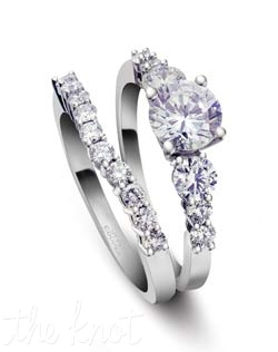 Simple and elegant, this round diamond bridal set features graduated size stones in the engagement ring, set in a shared prong style.  The diamonds are the highlight of this set, very little metal is visible at all.  Shown here in Platinum, but can also be fashioned in 18K gold.  We can custom adjust the center to fit virtually any shape and size stone you choose.  The band, R-3110/B(0.18 ct ttl) is sold separately, and is slightly curved to fit perfectly together with the engagement ring.  100% hand crafted in the USA R-3110 0.36 ct ttl