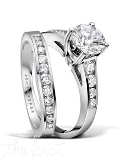 Platinum and round diamond bridal set from the Nikole Collection  The tapered channels focus your eye towards your center diamond, and together these rings form an elegant and clean set.  Shown with a round center, but can be custom crafted to whatever shape and size center stone you choose.  These rings sit seamlessly together on your finger.  100% hand crafted in the USA  R-3280 0.33 ct ttl, R-3280/B 0.28 ct ttl. Also available in white gold and yellow gold.