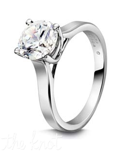 "Round solitaire engagement ring fashioned in platinum, from the ""Eternal  Collection""  The lattice work on each side of the ring creates a dramatic and unique setting  for your stone.  We have this style available in several widths depending on the size and shape of your stone.  The slightly beveled edges on the ring make it unique and sleek.  100% hand crafted in the USA. Also available in white gold, yellow gold, and rose gold."