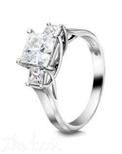 Classic  princess cut diamond three stone ring.  We are known for our Lattice Collection, of elegant and graceful wire work on the side profiles of this ring.  Many rings may look like ours, but look closer and deeper at our styles, the wires are clean and pronounced, polished inside and out, three dimensional wearable art.  You deserve nothing less for your engagement ring.  Shown here in Platinum, but can also be crafted in 18K gold.  We offer this style in a variety of side stone sizes and shapes to fit virtually any size and shape center.  100% hand crafted in the USA. R-3168 0.40cts.