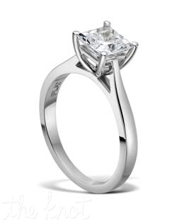Solitaire princess cut diamond engagement ring from the Duet Collection, shown in platinum.  This ring is available in several widths depending on the size and shape of your center stone, it can be custom designed for your asscher, cushion, emerald cut, etc.  The ring becomes more delicate at top towards the center to make your stone be more pronounced and important. 100% hand crafted in the USA. Also available in white gold, yellow gold and rose gold.