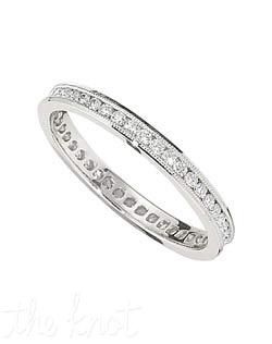 Ladies platinum and round diamond band, eternity band from the Heirloom Collection.  This delicate band can match a tremendous variety of engagement rings, or be worn alone, stacked, the possibilities to wardrobe this ring are endless.  Available in Platinum, and 18K.  The ring has a petite millgrain hand applied to the tops of the channel around the entire ring, for a vintage look and unique brilliance.  We have several different versions of this ring, in different diamond sizes, shapes and more.  100% hand crafted in the USA  R-3303/E  0.45 ct ttl.