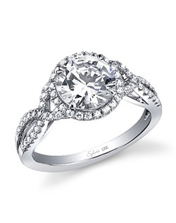 This unique 18K white gold diamond engagement ring features a 2.00 carat round brilliant center diamond. Beautifully designed to accentuate the center diamond, this engagement ring has a total of 0.33 carats of round diamonds surrounding the center diamond and flowing down this uniquely designed shank setting. The diamond engagement ring is available in any size or shape center, in 18K white gold or platinum. All Sylvie Collection engagement rings are available with a flush fit matching wedding band.