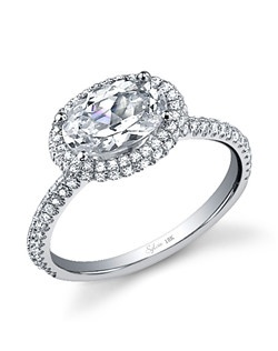 This Unique 18K white gold diamond engagement ring features a 1 carat Oval Cut center diamond. A total of 0.51 carats of round diamonds surround the center diamond and stream down the sides of the ring, accentuating the center diamond. This diamond engagement ring is available in any shape or size center stone in 18K white gold or platinum. All Sylvie Collection diamond engagement rings are available with a flush fit matching wedding band.