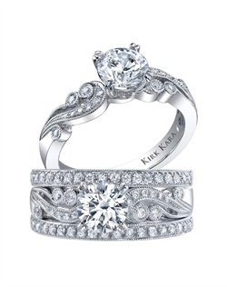 Award-winning handcrafted 3-ring engagement set from the Kirk Kara Angelique collection. Voted Best Bridal Design by fine jewelry retailers around the country, the engagement ring is crafted with 0.14 carats of diamonds (center stone not included). Shown with two matching wedding bands, each crafted with 0.19 carats of diamonds. Available in platinum or 18K white, 18K yellow or 18K rose gold. All Kirk Kara designs are handcrafted and tailored to accommodate your customization requests.