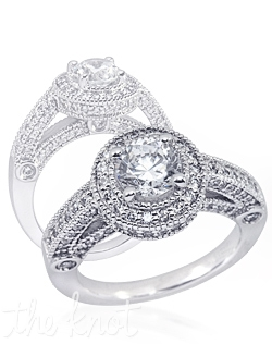 Shown in 14K white gold but also available in 18K or Platinum.  This ring contains approximately 1ct total weight of mele diamonds, not including the center stone.  This ring is designed for a round center stone.