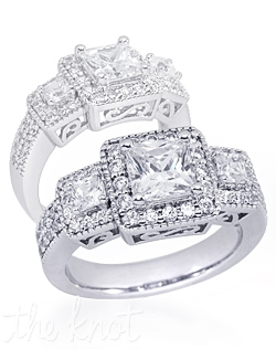 Shown in 14K white gold but also available in 18K or Platinum.  There are approx. 0.9 ctTW of melee and princess-cut side stones.  This ring is designed for a Princess-cut center stone.