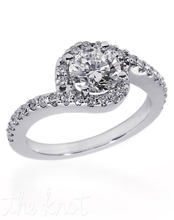 Shown in 14K white gold but also available in 18K or Platinum.  There are approx. 0.35 ctTW of melee diamond side stones.  This ring is designed for a round center stone.