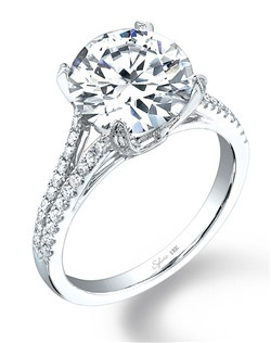 This stunning Platinum diamond engagement ring features a 1carat round brilliant diamond, featured in a split shank setting with round brilliant diamonds streaming down the sides totaling 0.33 carats. The diamond engagement ring is available in any shape or size center diamond in 18K white gold or platinum. All Sylvie Collection diamond engagement rings are available with a flush fit matching wedding band.