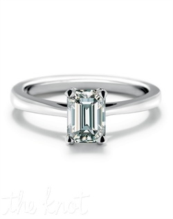 This solitaire engagement ring is set in 18k white gold and features an emerald Forevermark diamond. Rings are available in a range of sizes, qualities and metals.