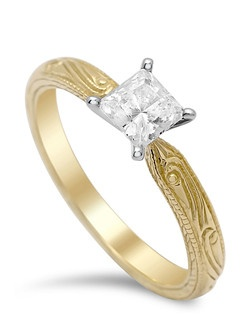 Simply elegant 4-prong engraved solitaire ring is delicately edge in milgrain and sits low on finger.