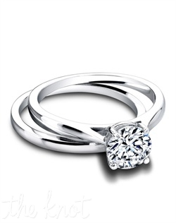 3263 & 3263/B (ring 1ct ttl ; band 0.20ct ttl ) Love is grand. And so we created the Tess Round Wedding Set, the very embodiment of grace and femininity. The Tess Wedding Band is a simple and chic partner with its own luminous glow. The Tess Round Engagement Ring is a timeless silhouette made new. Customize Tess with any stone you desire, virtually every cut you can imagine looks amazing. Hand crafted in either Platinum or 18k Gold.