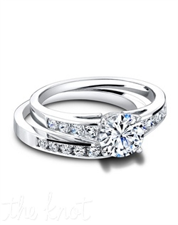 3280 & 3280/B (ring 0.33ct ttl; band 0.28ct ttl) The Nanette Engagement Ring's beautifully articulated prongs are the perfect place for the center stone of your dreams. The Nanette Wedding Band has a slight curve on one side of the channel to perfectly match its partner. With their graduated round diamonds in a chic channel setting, they form an exquisite wedding set. Hand crafted in either Platinum or 18k Gold.