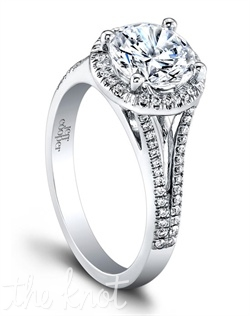 1502 (0.22ct ttl) Angelic, yet multifaceted. The Tempest Engagement Ring. In this unique engagement style, round accent diamonds form a halo that surrounds your center diamond. An eye catching design that makes your center stone the radiant center of attention. Available in several widths. Can be custom made to fit any shape center stone. Hand crafted in either Platinum, 18k or 14K Gold.