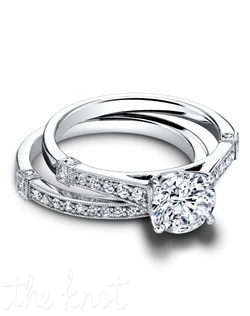 1600 & 1600/B(ring 0.19 ttl; band 0.28 ttl) Feminine and romantic. The Hope Set is an updated vintage style, set apart by uniquely embellished bands. Sparkling pavé diamonds draw attention to the center stone. Can be custom made to fit any shape center stone. Hand crafted in either Platinum, 18K and 14K Gold.
