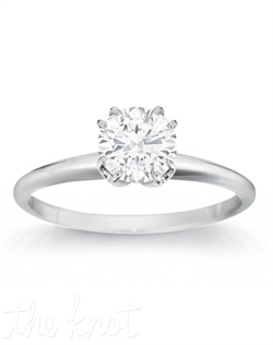 She will be charmed by this subtle solitaire showcasing a round center stone.