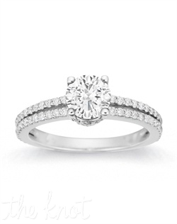 Captivating, stunning, timeless all aptly describe this ring. Gleaming stones along the split shank and encircling underneath the center stone intensify the impact.