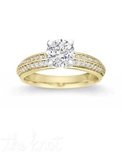 This tulip-shaped setting with Pave stones perfectly highlights a sparkling round stone center.