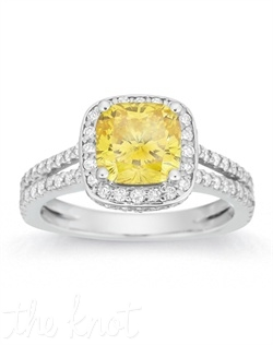Beautifully cradled in an intricately detailed setting, this ring features a beaming yellow cushion stone.