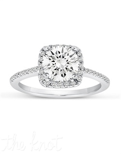 A spectacular array of diamonds surround a heavenly solitaire.