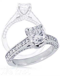 Criss-cross ribbon diamond engagement ring.  This ring is shown in 14K white gold with approx 0.75 cts TW of melee diamonds.
