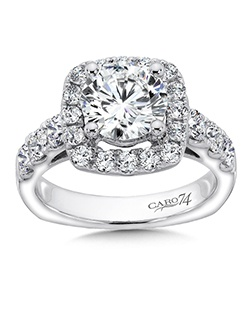 14K White Gold CARO 74 RING with platinum head. Ring features a round center stone accented by a cushion shape diamond halo, side stones, and sleek design.  Also available in white gold, yellow gold, 18K and Platinum. Price excludes center stone