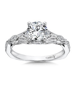 14K White Gold CARO 74 RING with platinum head. Center diamond is balanced by a pair of smaller diamonds and sleek vintage inspired metal design.  Also available in white gold, yellow gold, 18K and Platinum. Price excludes center stone