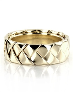 A chic style, this 7mm wide Hand Woven wedding band consists of a beautiful wide braid. This wedding ring is also available in 5, 6, 8mm. The band is high polished. Available in 14k, 18k, and platinum. Also available for women.