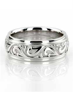 An attractive Antique design, this 7.5mm wide handcrafted wedding band has a lovely wave style, and beaded motif at the edges. This wedding band is also available in 6.5, 8.5, 9.5, 10.5, 11.5mm, and Two Color Gold. The band is high polished. Available in 14k, 18k, and platinum. Also available for women.