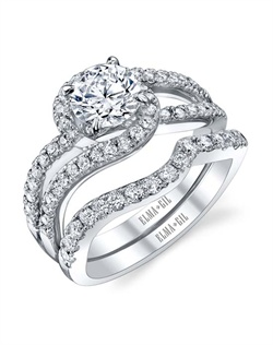This stunning bridal set is shown with a 1ct center diamond. Available in 18K white or yellow gold and platinum. Prong set for durability with diamonds calibrated to 1/100th of a millimeter. Settings can be custom made to fit any size or shape center stone. Total weight of semi-mount 0.51 Ct., total weight of matching band 0.35 Ct. Each piece sold separately.