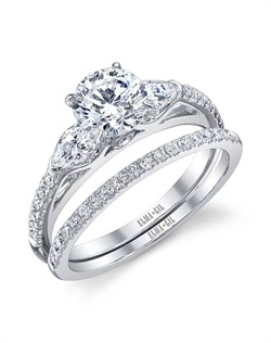 This stunning bridal set is shown with a 1ct center diamond. Available in 18K white or yellow gold and platinum. Prong set for durability with diamonds calibrated to 1/100th of a millimeter. Settings can be custom made to fit any size or shape center stone. Total weight of semi-mount 0.48 Ct., total weight of matching band 0.21 Ct. Each piece sold separately.