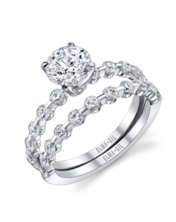 This stunning bridal set is shown with a 1ct center diamond. Available in 18K white or yellow gold and platinum. Prong set for durability with diamonds calibrated to 1/100th of a millimeter. Settings can be custom made to fit any size or shape center stone. Total weight of semi-mount 0.47 Ct., total weight of matching band 0.50 Ct. Each piece sold separately.