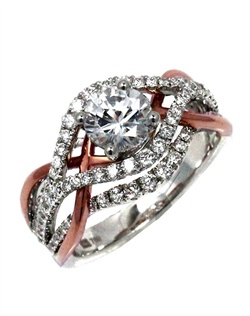With a twist of polish gold and diamonds, this ring yells. Fun, modern and breath-taking. This Sage ring is shown with white gold and diamonds, and pink polish gold. Available in any size center and metal. (Center not included). 92 DIA 0.85 CT