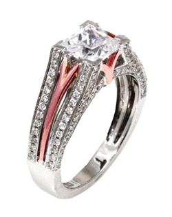 With diamonds surrounding almost every angle, this princess cut Sage ring will make any girl feel royalty. This ring is shown in white gold and diamonds with an inside pink gold polish. Available in any size center and metal. (Center not included). 124 DIA 0.64 CT