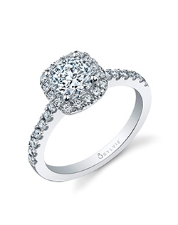 18K white gold engagement ring with 1-carat prong-set pear-shaped center diamond; 0.41 total carats of pave diamonds in halo and down shank. Available in platinum and in white, yellow or rose gold.