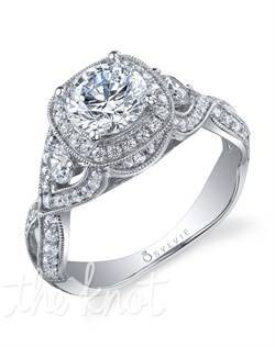 18K white gold engagement ring with 1-carat prong-set round brilliant center diamond; 0.82 total diamond carats in setting; cushion halo and round side diamonds surrounded by pave diamond twisted shank; milgrain edging. Available in platinum and in white, yellow or rose gold.
