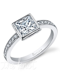 18K white gold engagement ring with 1-carat bezel-set princess center diamond; 0.16 total carats of pave diamonds in the channel shank. Available in platinum and in white, yellow or rose gold.