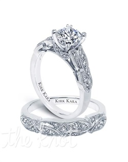 Handcrafted engagement set from the Kirk Kara Dahlia collection.  Engagement ring is crafted with 0.12 carats of diamonds (center stone not included). Shown with matching wedding band crafted with 0.10 carats of diamonds. Available in platinum or 18K white, 18K yellow or 18K rose gold. All Kirk Kara designs are handcrafted and tailored to accommodate your customization requests.