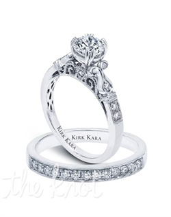 Handcrafted engagement set from the Kirk Kara Pirouetta collection.  Engagement ring is crafted with 0.12 carats of diamonds (center stone not included). Shown with matching wedding band crafted with 0.23 carats of diamonds. Available in platinum or 18K white, 18K yellow or 18K rose gold. All Kirk Kara designs are handcrafted and tailored to accommodate your customization requests.