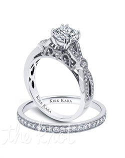 Handcrafted engagement set from the Kirk Kara Pirouetta collection.  Engagement ring is crafted with 0.20 carats of diamonds (center stone not included). Shown with matching wedding band crafted with 0.14 carats of diamonds. Available in platinum or 18K white, 18K yellow or 18K rose gold. All Kirk Kara designs are handcrafted and tailored to accommodate your customization requests.